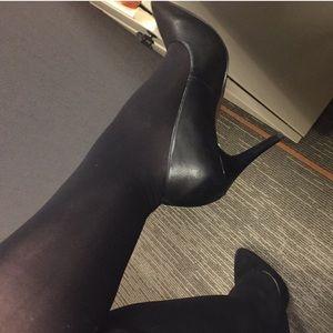 Well worn black tights